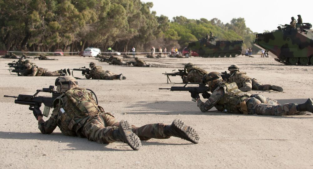 Spanish Navy Marines take position during a military exercise on the Garrucha beach near Almeria, Spain, Tuesday, Oct.21, 2014. NATO warships are exercising in the Mediterranean Sea and Atlantic Ocean as part of a NATO Response Force training to test its crisis response capabilities with over 23 warships