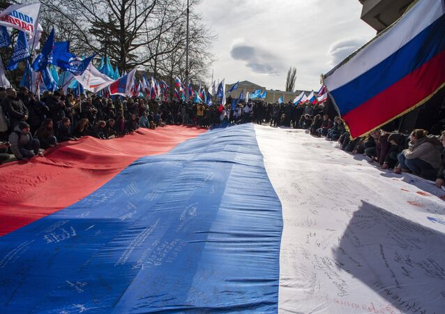 Participants of a rally celebrating the Crimean Spring's first anniversary in front of the Crimean State Council in Simferopol.