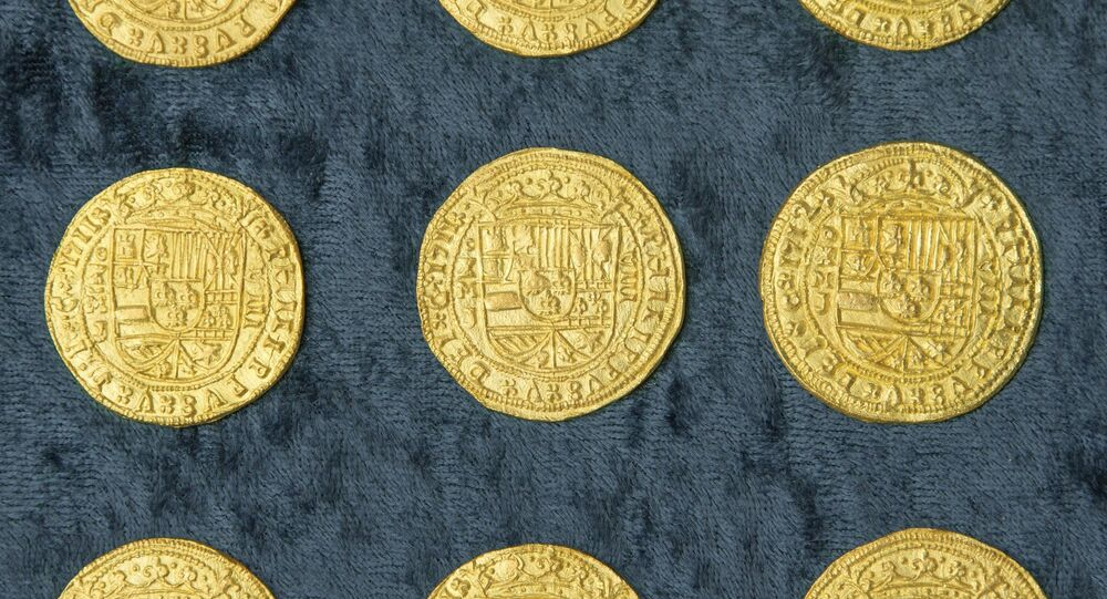 Over 350 gold coins from a sunken Spanish Treasure are seen in an undated handout picture courtesy of 1715 Fleet - Queens Jewels