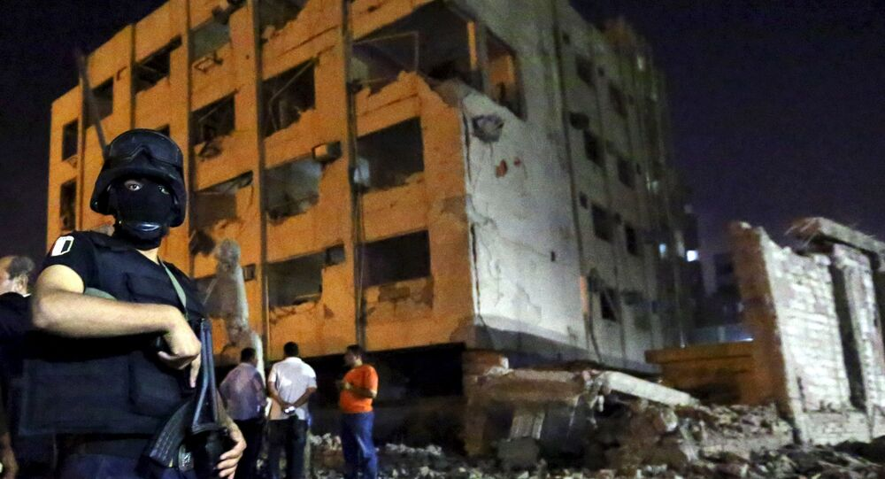 A security official stands guard at the site of a bomb blast at a national security building in Shubra Al-Khaima, on the outskirts of Cairo, August 20, 2015