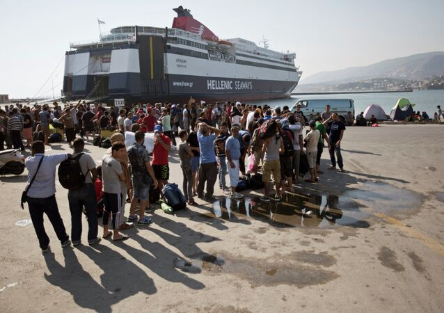 Syrian migrants wait in line to buy ferry tickets at the port in Mytlilene, Lesbos in Greece, Thursday, Aug. 20, 2015.
