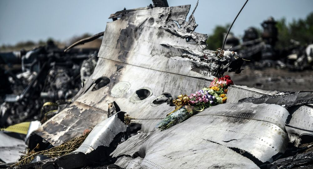 A picture taken on July 26, 2014 shows flowers left by the parents of an Australian passenger on the wreckage of the Malaysia Airlines MH17 near the village of Hrabove (Grabove) in the Donetsk region
