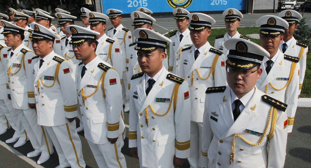 Chinese Navy officers during a ceremony of welcoming the crews of Chinese warships involved in the Naval Cooperation 2015 exercise