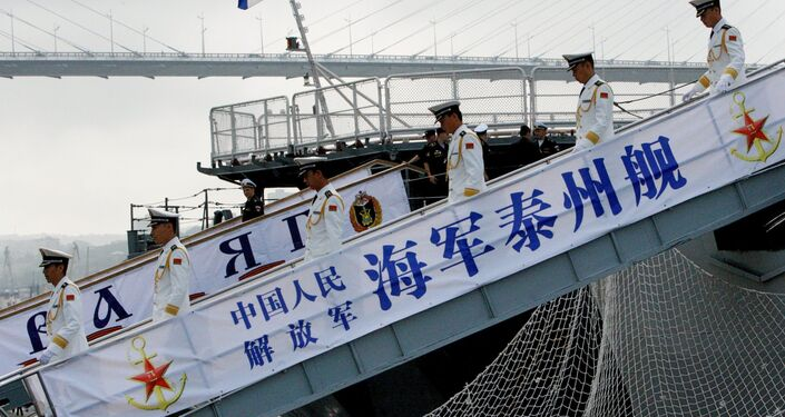 Sailors from the destroyer Taizhou that has arrived in Vladivostok together with six other Chinese warships for the second stage of the Naval Cooperation 2015 exercise.