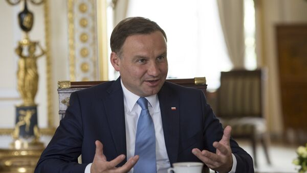 Poland's President Andrzej Duda gestures during a Reuters interview at the Presidential Palace in Warsaw, Poland August 14, 2015 - Sputnik International