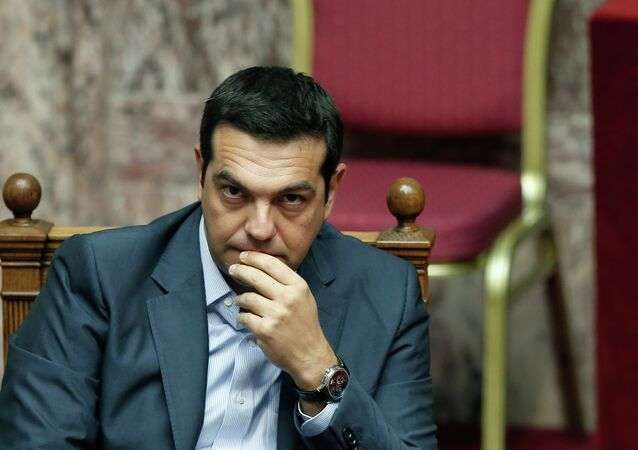 Greek Prime Minister Alexis Tsipras listens during a parliamentary session in Athens, Friday, Aug. 14, 2015
