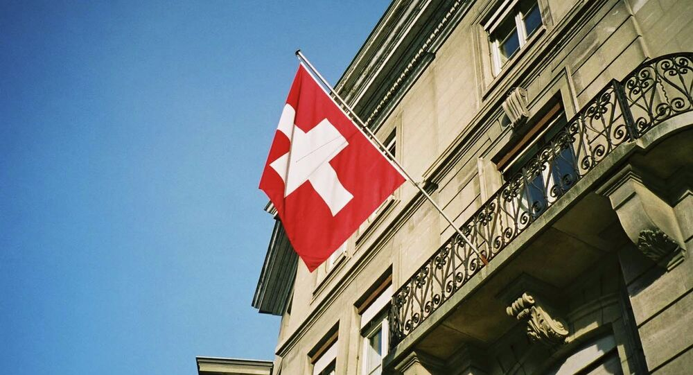Swiss flag fluttering in the sunshine in Geneva