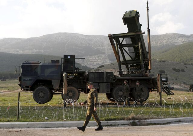 Soldiers of the German armed forces Bundeswehr stand next to the Patriot system before the arrival of Germany's Chancellor Angela Merkel at a Turkish military base in Kahramanmaras in this February 24, 2013