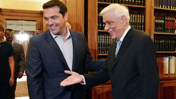 Greek Prime Minister Alexis Tsipras (L) is greeted by Greek President Prokopis Pavlopoulos at the presidental palace in Athens on August 20, 2015 - Sputnik International
