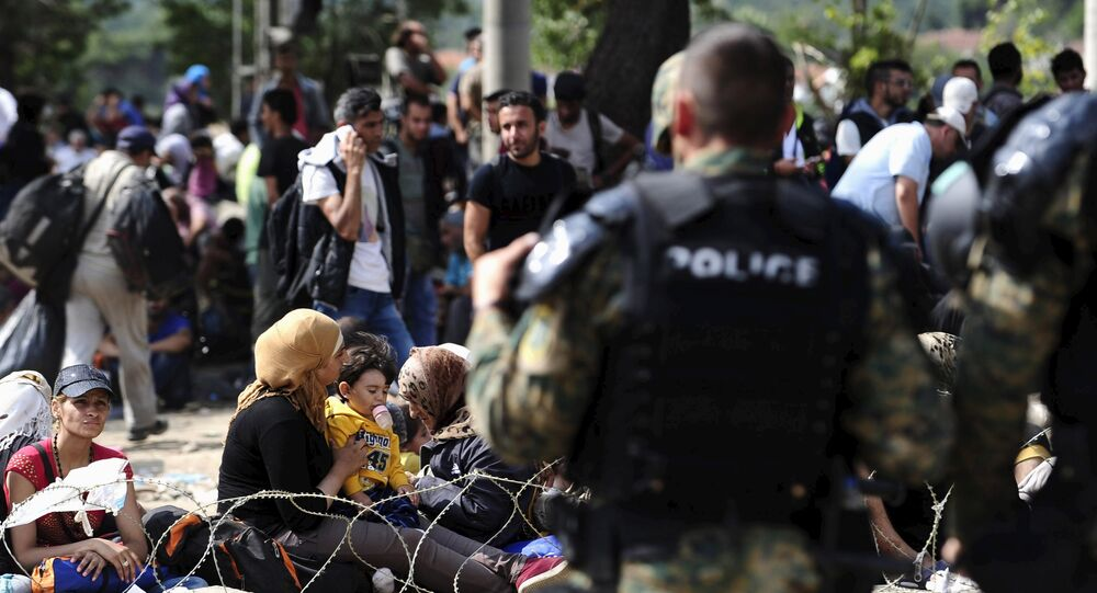 Macedonian special policemen guard the border as more than a thousand immigrants wait at the border line of Macedonia and Greece to enter Macedonia near the Gevgelija railway station August 21, 2015