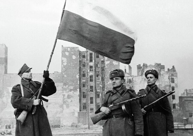 Soldiers of Wojsko Polske (left with flag) and the Red Army (right) raising a flag in liberated Warsaw