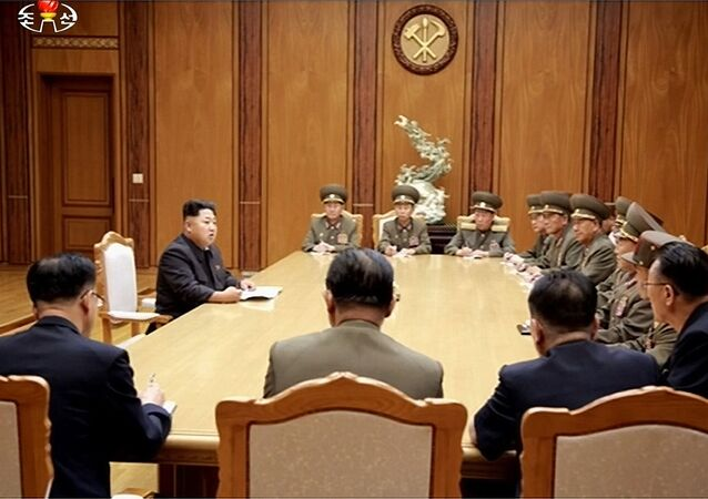 This screen grab taken from North Korean TV and released by South Korea's news agency Yonhap on August 21, 2015 shows North Korean leader Kim Jong-Un (2nd L) during an emergency meeting of the powerful Central Military Commission on August 20, 2015