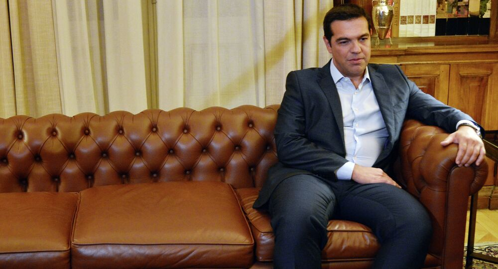 Greek Prime Minister Alexis Tsipras meets with president of Greek republic, Prokopis Pavlopoulos (not pictured) at the presidental palace in Athens on August 20, 2015