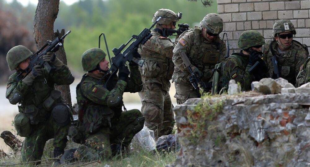 Members of the US Army 173rd Airborne Brigade and Lithuania's soldiers practice during the combined Lithuanian-US training exercise at the Gaiziunai Training Area some 110 kms (69 miles) west of the capital Vilnius Lithuania, Tuesday, July 7, 2015