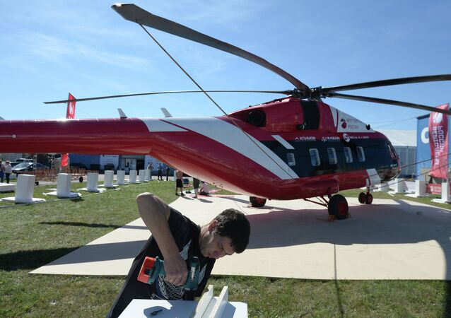 A MAKS 2015 participant prepares a Mi-38-2 helicopter for a flight program at the MAKS 2015 International Aviation and Space Salon