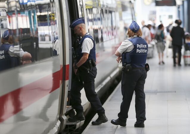 Belgian police officers enter a train during a patrol at the Thalys high-speed train terminal at Brussels Midi/Zuid railway station