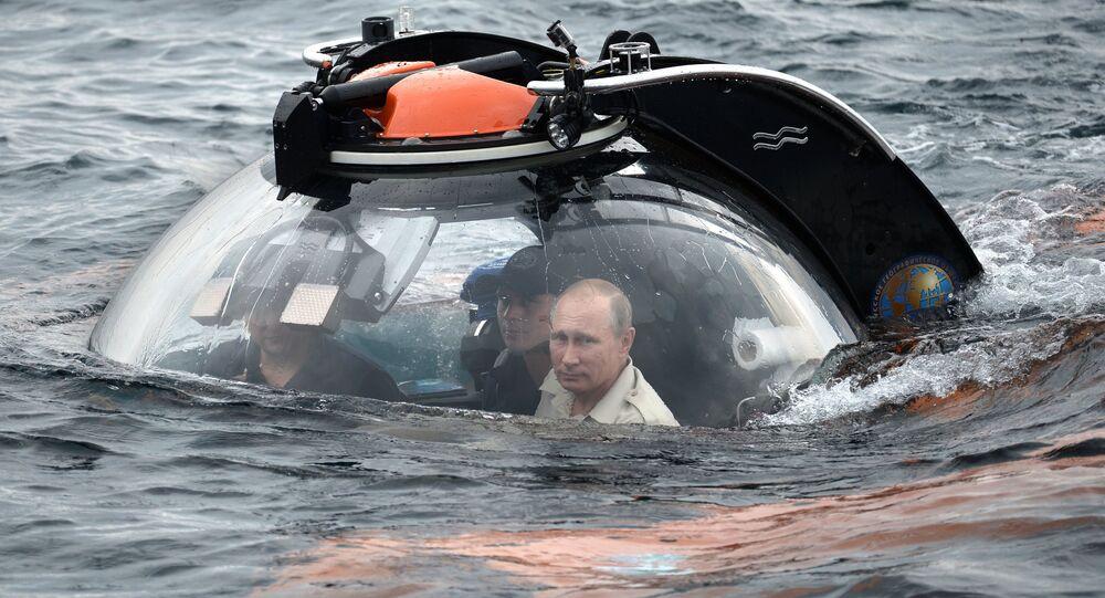 Russian President Vladimir Putin, right, submerges 83 meters under water on board a bathyscaphe near Sevastopol to see a sunken ancient vessel