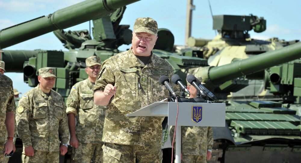 Ukrainian President Petro Poroshenko delivers a speech during a ceremony marking the handing over of heavy military equipments to Ukrainian forces in northeastern town of Chuguev , Kharkiv region on August 22, 2015