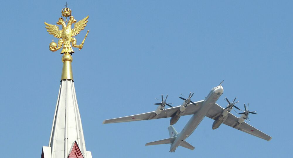 Tupolev 95 strategic bombers fly over Red Square during the Military Parade dedicated to the 65th anniversary of the Victory in the Great Patriotic War