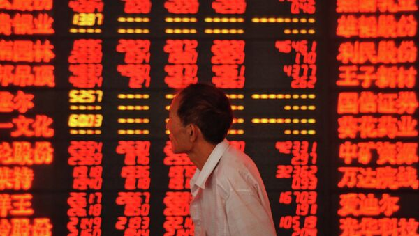 An investor checks stock market prices at a securities firm in Fuyang, in eastern China's Anhui province - Sputnik International