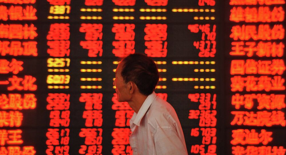 An investor checks stock market prices at a securities firm in Fuyang, in eastern China's Anhui province