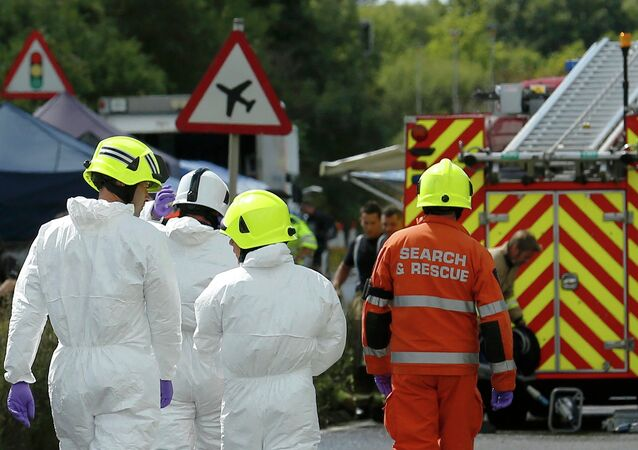 Emergency services and crash investigation officers work at the site where a Hawker Hunter fighter jet crashed onto the A27 road at Shoreham near Brighton, Britain August 23, 2015