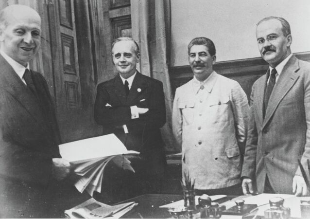 Soviet Commissar for Foreign Affairs Vyacheslav Mikhailovich Molotov, far right, General Secretary of the Communist Party Josef Stalin, second from right, and German Reich Foreign Minister Joachim von Ribbentrop, third from right, pose together after signing the German-Soviet non-aggression pact in Moscow, August 23, 1939