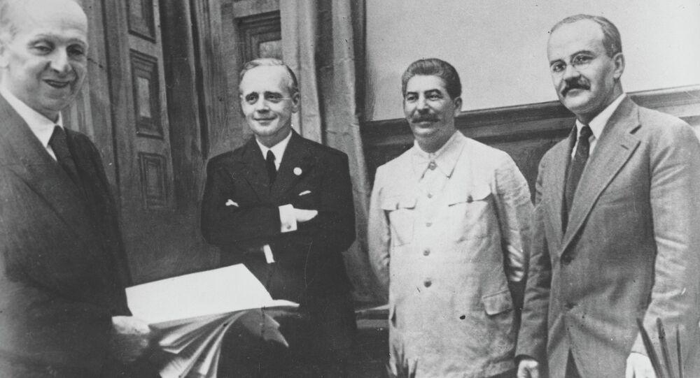 Soviet Foreign Minister Vyacheslav Molotov, far right, Soviet leader Joseph Stalin, second from right, and German Foreign Minister Joachim von Ribbentrop, third from right, posing after signing the German-Soviet non-aggression pact in Moscow, August 23, 1939.