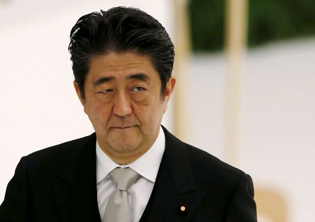 Japan's Prime Minister Shinzo Abe attends a memorial service ceremony marking the 70th anniversary of Japan's surrender in World War Two at Budokan Hall in Tokyo