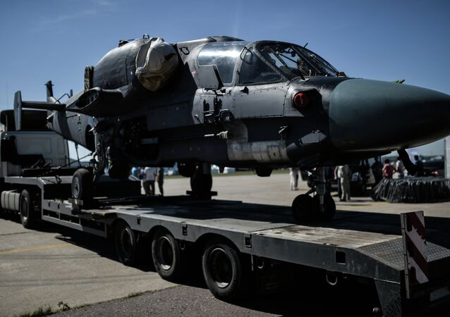 A Ka-26 helicopter is transported for the final rehearsal of the opening of the MAKS 2015 International Aviation and Space Salon