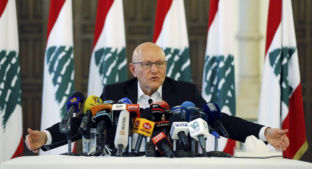 Lebanon's Prime Minister Tammam Salam speaks during a news conference at the government palace in Beirut, Lebanon