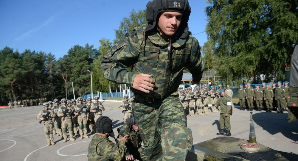 A serviceman of the CSTO's Collective Rapid Deployment Forces hold the Interaction 2015 joint drill in the Pskov Region