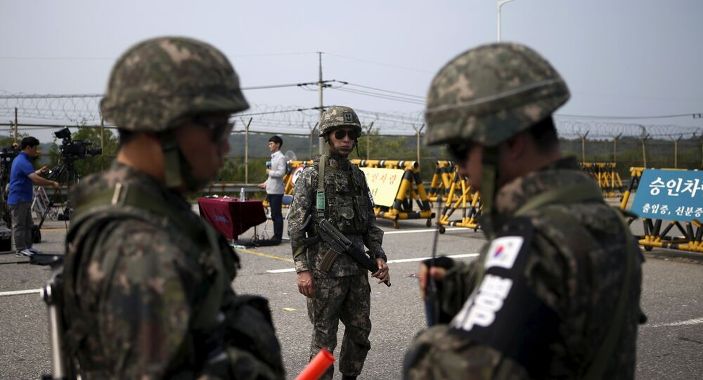 South Korean soldiers stand guard at a checkpoint on the Grand Unification Bridge which leads to the truce village Panmunjom, just south of the demilitarized zone separating the two Koreas, in Paju, South Korea
