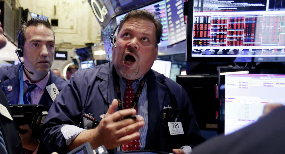 Trader John Santiago, center, works on the floor of the New York Stock Exchange, Monday, Aug. 24, 2015