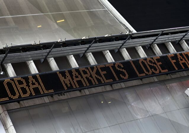 A headline about the global sell-off in stocks is displayed on the Times Square Zipper in New York, August 24, 2015