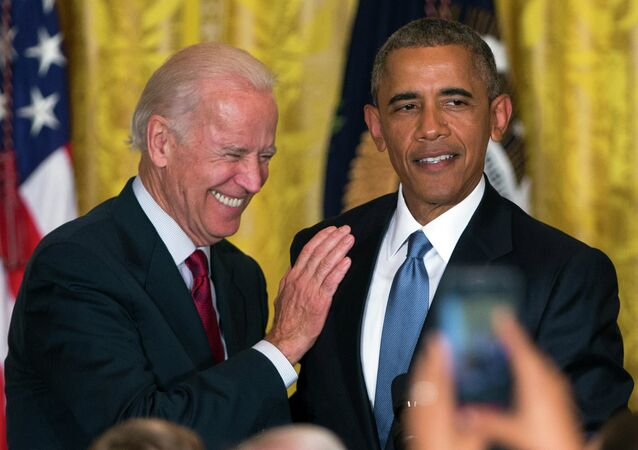 Vice President Joe Biden and President Barack Obama react after a heckler is removed from the East Room of the White House.