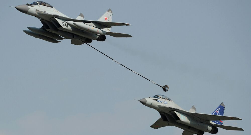 Russian multi-purpose jet fighters MiG-29, left, and MiG-35 perform a demonstration flight at the MAKS-2011 international air show in Zhukovsky near Moscow