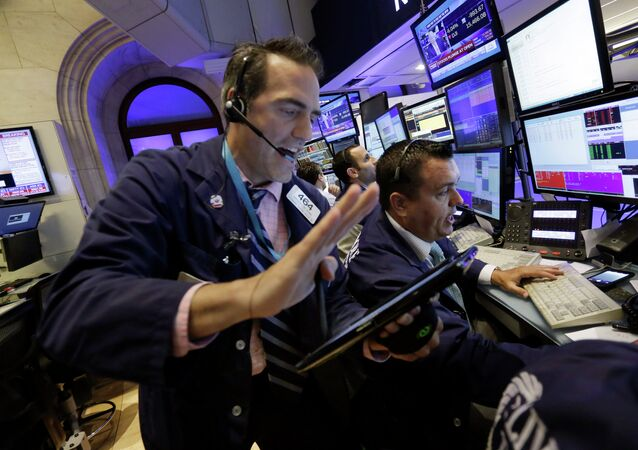 Traders Gregory Rowe, left, and Robert Finnerty work in a booth on the floor of the New York Stock Exchange, Monday, Aug. 24, 2015