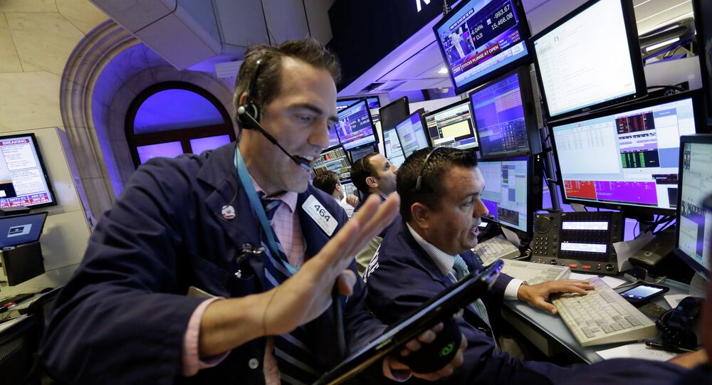 Traders Gregory Rowe, left, and Robert Finnerty work in a booth on the floor of the New York Stock Exchange, Monday, 24 August 2015