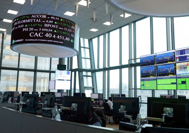 Stock market operator Euronext's unversal analysts work in the market services surveillance room center at the new Euronext headquarters in the La Defense business district, near Paris