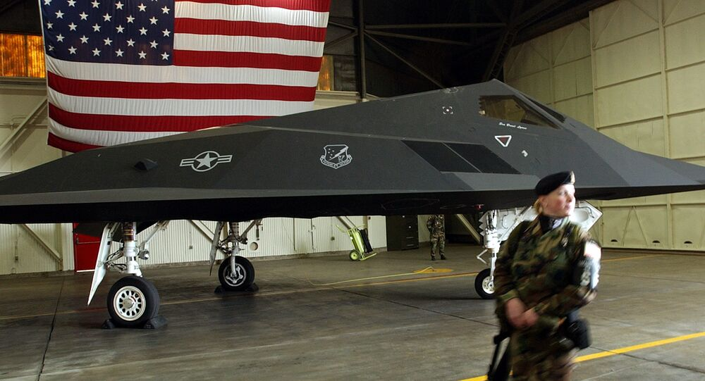 An US Air Force soldier patrol the perimetre around a F-117 Nighthawk stealth fighter jet