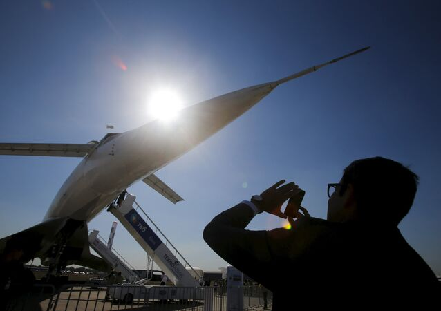A visitor takes a picture of a Tupolev Tu-144 commercial supersonic transport aircraft on display at the MAKS International Aviation and Space Salon in Zhukovsky, outside Moscow, Russia, August 25, 2015