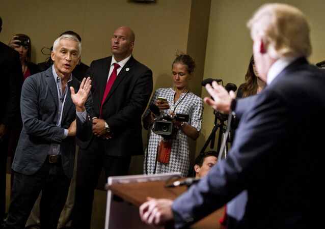 Republican presidential candidate Donald Trump spars with Univision reporter Jorge Ramos before his Make America Great Again Rally at the Grand River Center in Dubuque, Iowa, August 25, 2015