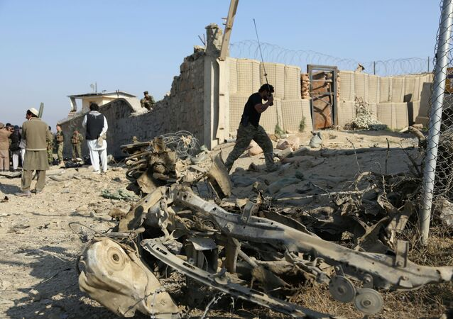 Afghan officials investigate the site of a deadly suicide attack on a joint NATO-Afghan base in the Ghani Khail district of Nangarhar province, east of Jalalabad, Afghanistan. File photo