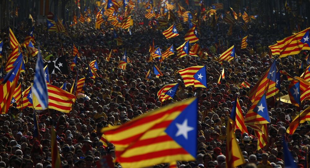 """Hundreds of thousands of demonstrators stand on the streets waving their """"estelada"""" flags, that symbolizes Catalonia's independence, during a protest calling for the independence of Catalonia in Barcelona, Spain"""
