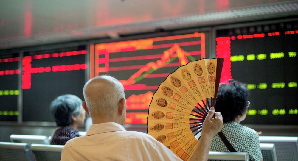 Investors look at screens showing stock market movements at a securities company in Beijing on July 28, 2015