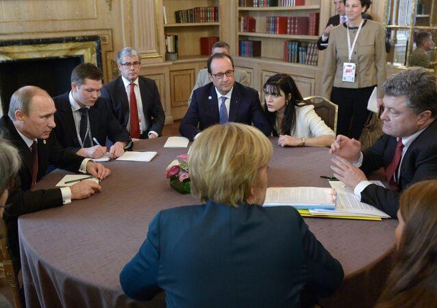 October 17, 2014. Russian President Vladimir Putin (left), Ukrainian President Petro Poroshenko (right), German Chancellor Angela Merkel (near center), and French President Francois Hollande (far center) during a meeting in the Normandy format on the sidelines of the ASEM Summit