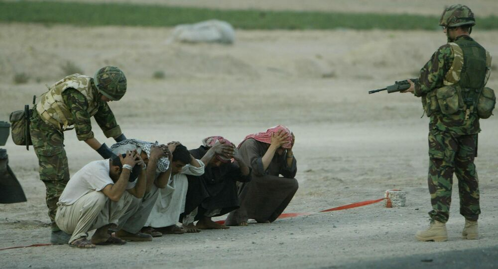 British soldiers with the 1st Armoured Division stops and search Iraqis Monday March 24, 2003, at a checkpoint on the road to Basra. Security around military convoys and encampments has been stepped up after British Army officers warned that their soldiers had come under attack from guerrilla-style paramilitary shootings in southern Iraq