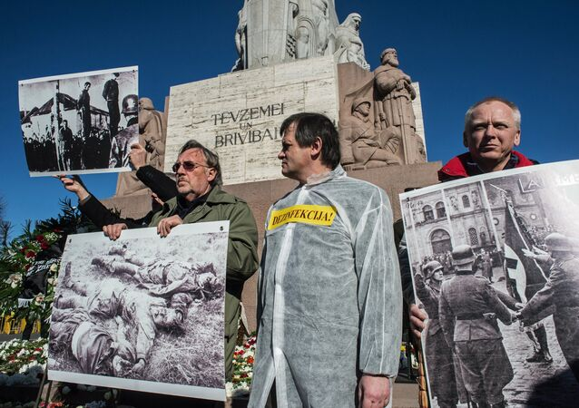 Antifascists hold an action protesting public events held on the occasion of the day of memory of the Latvian Legion Waffen-SS at the Freedom Monument in Riga
