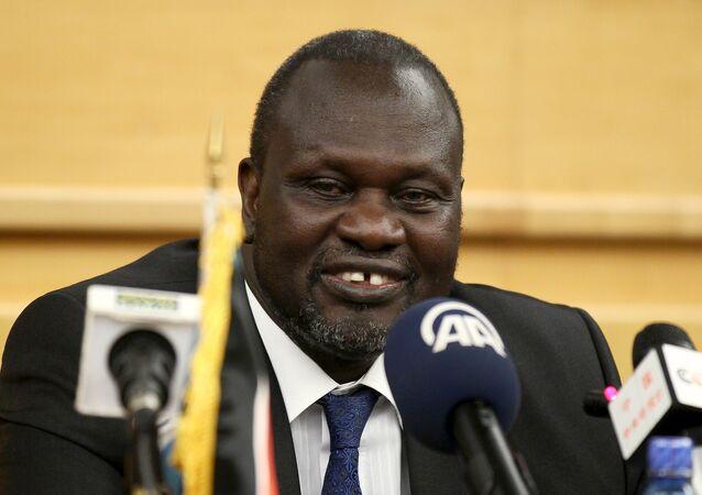 South Sudan's rebel leader Riek Machar prepares to address a news conference.